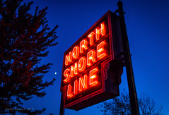 The North Shore Line (Wheelnrail) Tags: north shore line neon red chicago irm illinois railway museum train trains advertisement blue hour moon evening
