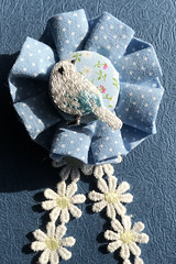 blue bird in rosette (unikto) Tags: rosette blue bird rose marguerite ribbon flower craft hand work peace calm