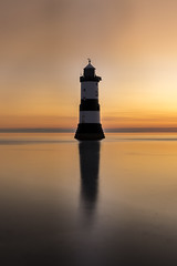 Sunrise (michaelmckenna11) Tags: lighthouse sunrise light fire morning reflection reflections seaspray seascape irishsea penmon anglesey wales northwales early photo photograph inexplore longexposure