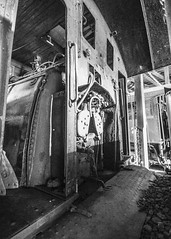 Office Space (trainmann1) Tags: train trains rail railroad rails blackandwhite blackwhite bw desaturated eastbroadtop eastbroadtoprailroad ebtrr ebt orbisonia pa pennsylvania rockhillfurnace roundhouse engine steamengine steamlocomotive locomotive steamer mikado baldwin 280 antique relic abandoned neglected rusty crusty nikon d7200 tokina 1116mm amateur handheld inside indoors shadows dark summer june 2018 firebox cab doors rivets coal