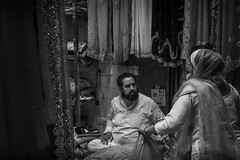 bartering at the saree market (charlesgyoung) Tags: saree market delhi d500 olddelhi india charlesyoung nikon nikonphotography nikondx streetphotography blackandwhite