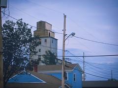 Small Town Skyscraper (RandallMcRoberts) Tags: artphotography blue buildings cityscape elevator fineartphotography grainelevator smalltown