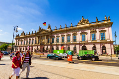 Wir sind ein Volk (Raoul Pop) Tags: relief act building art street people germany time cobblestone portico structure doric berlin person summer historic flag statue travel neoclassic car walking object pediment column technology descriptor architecture trip de