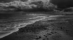Spurn Point Beach (jlnurse100) Tags: beach groynes sea sky sun clouds stones tide wave wash black white