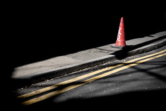 Cone Alone (Sean Batten) Tags: europe london england uk leakestreet waterloo streetphotography street light shadow cone nikon d800 35mm lines red yellow pavement road