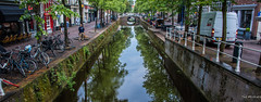 2018 - Delft - Canal - 3 of 4 (Ted's photos - Returns Late November) Tags: 2018 cropped delft nikon nikond750 nikonfx tedmcgrath tedsphotos vignetting canal canalscene canalscenedelft delftcanal streetscene street bikes bicycles reflection waterreflection bridge canalbridge delftcanalbridge canalbridgedelft railing seating seats