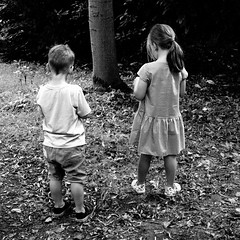 Sibling solitude (rosberond) Tags: children boy girl siblings canonefs1785mmf456isusm mono bw blackandwhite solitude countryside alone together