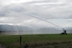 Irrigating a field (Randy Gardner 88) Tags: field fields pasture water irrigation watercannon farm farmers clouds skies sky humboldtcounty humboldt humboldtcountycalifornia