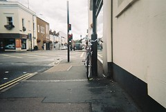 street bike (johnnytakespictures) Tags: disposable disposablecamera singleuse smile pocketsocket 35mm film analogue leamingtonspa leamington warwickshire bike bicycle cycle wheels transport vintage retro classic street chain chained lock locked