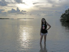 Girl and The Sea (PelicanPete) Tags: sea water sky sunset mutedtones niece goddaughter summer2018 pose floridakeys fun calm gulfofmexico ocean