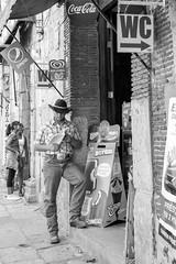 A cowboy in Oaxaca (Marcos Núñez Núñez) Tags: vaquero cowboy streetphotography urban oaxaca blackandwhite bw streetphotographer calle canoneosrebelt5 sombrero lectura botas pepsi cocacola wc cinturón belt holanda