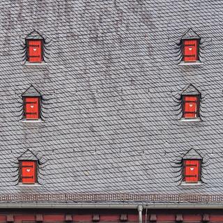 Slate roof with six dormers