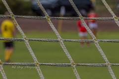 Back of the net (Malcom Lang) Tags: soccer football sport oval players net goals rope knots sqaures depthoffield yellow red white black green southaustralia southern south southernaustralia southerneyrepeninsula eyrepeninsula eyre lowereyrepenninsula canoneos6d canon100400ef