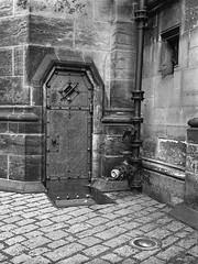 The Door (petr.skuta) Tags: gothic fuji gs645s ilford hp5 architecture r09 prague castel bw medium format rangefinder 6x45 mediumformat analogue diy fomadon negative film iso400 church fujifilm