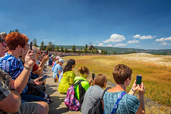 Waiting and Watching (KPortin) Tags: yellowstonenationalpark crowd hbm benches cameras