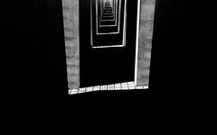 Between The Darkness (Sean Batten) Tags: berlin germany de memorialtothemurderedjewsofeurope blackandwhite bw nikon d800 35mm city urban light shadow