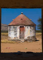 Experimental circular house for the local people built by the portuguese, Namibe Province, Caraculo, Angola (Eric Lafforgue) Tags: africa angola angola180265 architecture builtstructure caracul caraculo circle circular colourimage day developingcountries fulllength house karakul moçâmedes nopeople nonurbanscene outdoors photography portuguesecolony postoexperimental poverty rondavel rustic simplicity vertical village namibeprovince ao