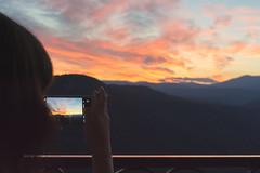 (Rory Holmes) Tags: france sunset sky nikon iphone landscape mountains clouds orange blue silhouette candid bokeh 35mm travel outside europe girl woman balcony portrait skyline cigarette smoke sun