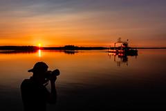 Ferry boat crossing a lake in Finland. (VisitLakeland) Tags: finland lakeland auringonlasku autolautta backlight evening ferry hphotographer järvi lake lossi silhuet siluetti sunset uilta vastavalo