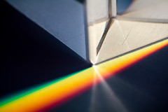 Light and Dark...Side of the Moon? (aronalison) Tags: prism prismmacro macro macromondays glass light rainbow color colours colour shadow black geometretic geometry triangle triangles beautiful darksideofthemoon pinkfloyd hmm