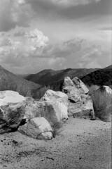 Rocks, Hills, and Clouds (squirtiesdad) Tags: clouds hills rocks hesperia diyfilmscanning selfdeveloped epson v600 monochrome blackandwhite bw bwfp analogue analog arista aristaedu iso100 35mm film vivitar 220sl notch