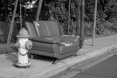 Take a Seat (John Brighenti) Tags: photography sony alpha a7ii ilce7m2 blackandwhite bw desaturated couch curb free hydrant road sidewalk concrete asphalt forsale trees tree leaves black white rockville maryland md twinbrook