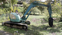Turquoise Tractor (JamCanSing) Tags: tractor backhoe heavyequipment hoe bulldozer bokeh pano bokehpanorama brenizer panorama sony sonysg sonyalphaprofessionals