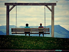 Enjoying the view (clickclique) Tags: swing frame sky clouds mountains hill grass flowers big archives quebec gaspe newbrunswick longchains