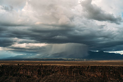 Localized rain on the mountains. (michael spear hawkins) Tags: lenstagger nm adaptedlens august2018 bridge clouds desert erosion localized mirrorless mountains newmexico outside partlycloudygorge rain rainshower riogrande riograndegorge riograndegorgebridge sky sony sonya7riii sonymirrorless storm sunset taos town vintagelens