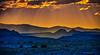 Godbeams and Buttes II (William Horton Photography) Tags: capitolreefnationalpark cathedralroad cathedralvalley utah aerialperspective crepuscularrays desert godbeam nationalpark panorama redrocks sunburst sunrays sunset unitedstates us