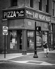 Late Night Slice (tim.perdue) Tags: arena district downtown urban city columbus ohio ua creative photowalk nikon d5500 nikkor 18140mm street late night slice pizza mikeys restaurant pizzeria corner storefront shop door window sign booze walk crosswalk do enter sidewalk man person figure candid black white bw monochrome