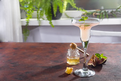 Bellini cocktail with peach and figs, honey on brown background over windows with flowers , copy space (lyule4ik) Tags: rose cocktail drink alcohol beverage glass ice juice liquid pink raspberry cold cool frozen fruit party red summer champagne sparkling gin background bar berry closeup collins diet fizz fresh green healthy lemon lemonade longdrink mineral mint mixed modern natural punch refreshment soda stylish sweet traditional vodja water alcoholic liquor wine