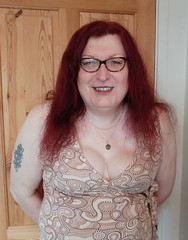 Multi patterned dress semi close up1 (dianne66uk) Tags: transwoman heels hosiery redhair glasses