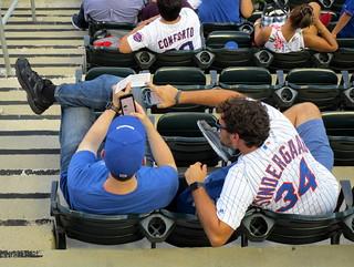 Citi Field, 08/04/18 (NYM v ATL): two fans reading the