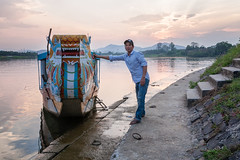 The dragon and his master (Asian Hideaways Photography) Tags: boatman boat dragon river sunset hue vietnam vietnamese people peoplevietnam