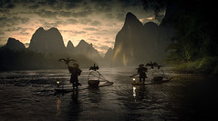 In the land of fairy tales (Massetti Fabrizio) Tags: guilin guangxi giallo guanxi green yangshou yangshuo cina china nikond4s 2470f28 fabriziomassetti famasse fishermen river yellow red clouds color cormorant landscape landscapes light fog mountain mount