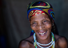 San tribe woman smiling portrait, Huila Province, Chibia, Angola (Eric Lafforgue) Tags: adult africa africanculture africantribe angola angola180066 angolan black bushmen chibia colourimage cultures darkbackground day developingcountries ethnicgroup happiness headshot horizontal humanbeing indigenousculture khoesan lifestyles lookingaway necklace nonurbanscene oneperson onewomanonly photography portrait realpeople ruralscene san smile smiling tribal tribe huilaprovince ao