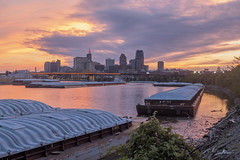 Sunset along the St. Paul Riverfront (Sam Wagner Photography) Tags: sunset vibrant colorful orange mighty mississippi river boat barge ship reflections dramatic sky lafayette bridge downtown st paul skyline city cityscape minnesota capitol riverfront architecture buildings