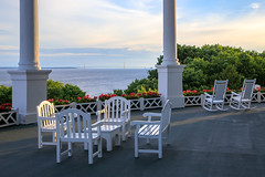 Evening On The Porch (Robert F. Carter Travels) Tags: grandhotel greatlakes lakehuron mackinacisland mackinawbridge thegrandhotel porch porches table chairs rockingchairs evening sunset evenings sunsets