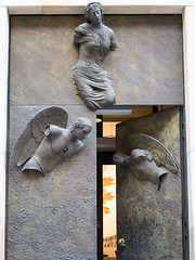 Entrance to Jesuit Church, Old City, Warsaw, Poland (msadurski) Tags: warsaw t architecture mitoraj door gm5 lumix 1232