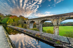 Chirk Aqueduct And Viaduct (Adrian Evans Photography) Tags: grass autumn rail bridge water chirkaqueduct wales uk northwales architecture railway footpath stone path landscape landmark reflections viaduct walkway llangollencanal llangollen clouds trees british canal fall victorian aqueduct river adrianevans train 1801 outdoor footbridge ceiriogvalley chirk thomastelford sky