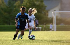 Light on defense (stephencharlesjames) Tags: soccer football womens sport college sports ncaa action ball light hair middlebury vermont