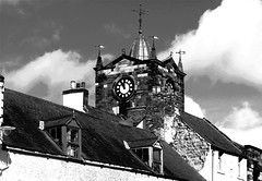 Town Clock (Snapshooter46) Tags: alnwick northumberland townclock townhall monochrome blackandwhite photosketch rooftop dormers weathervane