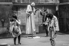 I'm Yoda.... Not E.T. (Cycling-Road-Hog) Tags: blackwhite candid canoneos750d citylife colour efs55250mmf456isstm edinburgh mobile monochrome people phone places royalmile scarf scotland street streetperformer streetphotography streetportrait style urban