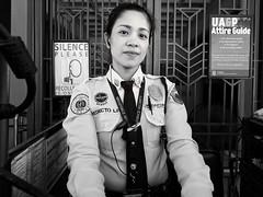 Stranger 62/100 (Stitch) Tags: 100strangers hellostranger stranger lady pretty guard receptionist frontdesk school portrait blackandwhite woman security