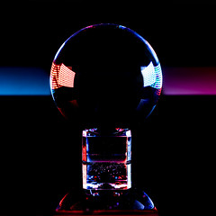 Crystal Ball (melmark44) Tags: led videolights symmetry magic multicolor future gypsy fortuneteller glass 3inchcrystalball refraction reflection rimlight macro colors colorful 5d4 5dmkiv canon crystalball glassball canoneos5dmarkiv ef100mmf28macrousm creative iso100 100mm fullframe tabletop desktop f80 04sec primelens macrolens blackacrylicsurface squarecrop closeup red blue sidelight dust sphere curved orb globe