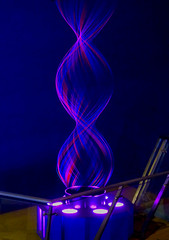 Spiraling Up (Steve Taylor (Photography)) Tags: spiral lights colourful blue red mauve singapore asia shape geometric vortex