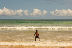 Down by the Sea, Senegal (Geraint Rowland Photography) Tags: summer summertime tones instagram editing lightroom editingphotos makingphotospop dakar yoffbeachinsenegal africans downbythesea tide surf ocean boy play saturatedphotos oldstyle sky nature beautyinnature wwwgeraintrowlandcouk