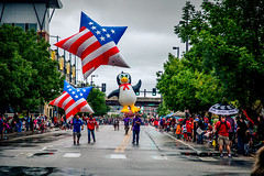Penguin and Pride (rg69olds) Tags: 09032018 5dmk4 canonef24105mmf4lisusm canoneos5dmarkiv nebraska canon downtown laborday omaha parade people rain pride penguin starsandstripes rainy walking