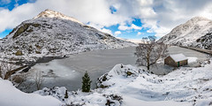 Ogwen Lake Winter Snowdonia (Adrian Evans Photography) Tags: llynogwen welshlandscape ogwenlake landscape winter welshmountain welshlandmark landmark weir icy outdoor tryfanmountain wales snowdonia snowcapped ogwenvalley penyrolewen snow snowdonianationalpark snowfall tree uk adrianevans northwales tryfan sky panorama ogwen lake clouds ice d850 nikon 20mm treesdiestandingup